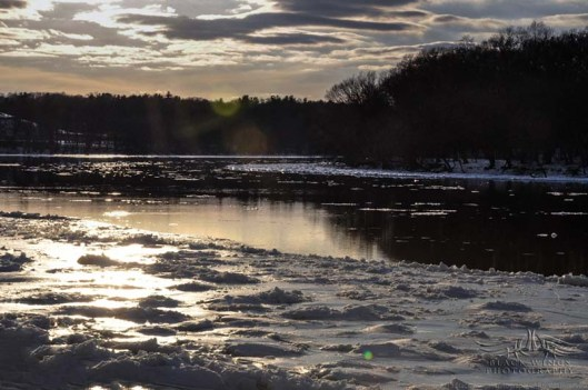 Looking upriver, the scene is shadowed by the anticipated sunset.