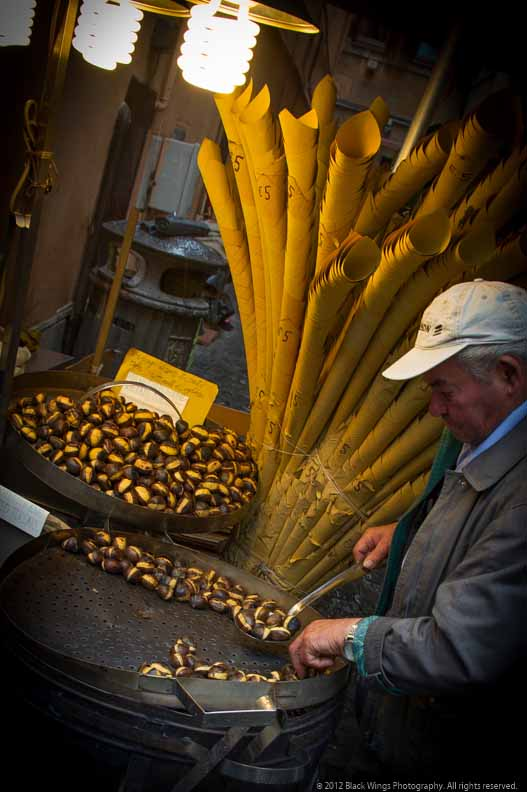 Stop and warm your hands over the chestnut vendor's roaster near the Trevi Fountain.